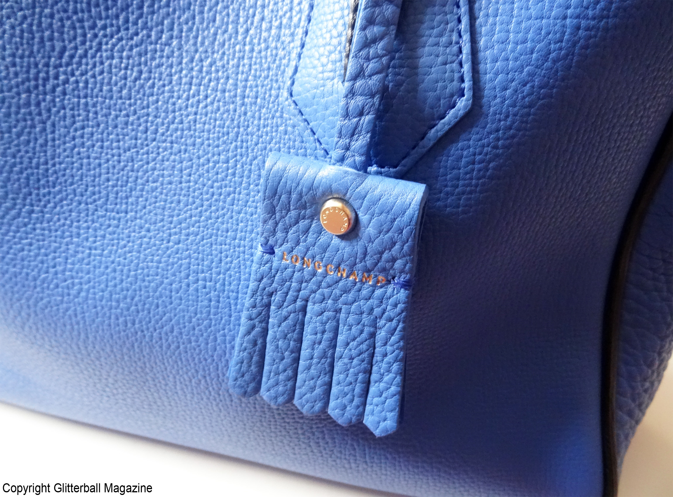 f0393694c668 This Longchamp Penelope tote bag is perfect for day or night. It s a great  size for holding notebooks